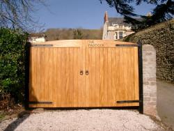 Wooden convex driveway gates - Devon county gate